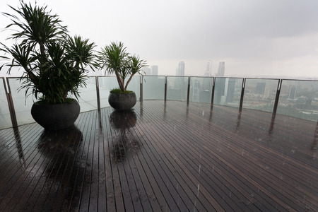 On the lookout of a skyscraper in the rain with views of Singapore  photo