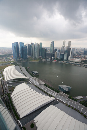 differs: SINGAPORE - NOVEMBER 06, 2012: Rain clouds in the sky before the rain over Singapore. Weather in Singapore differs monsoon tropical climate, so here comes the big monthly rainfall.  Editorial