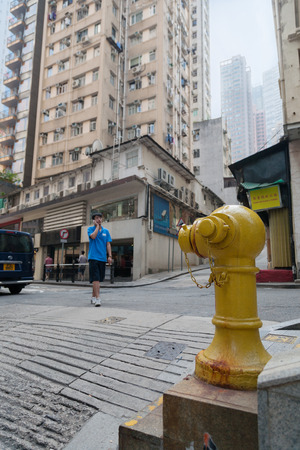ensuring: HONG KONG - NOVEMBER 14, 2012: Fire hydrant on the street in Hong Kong. Fire safety is an important component in ensuring the overall safety of the people in a densely built-up city such as Hong Kong. Editorial