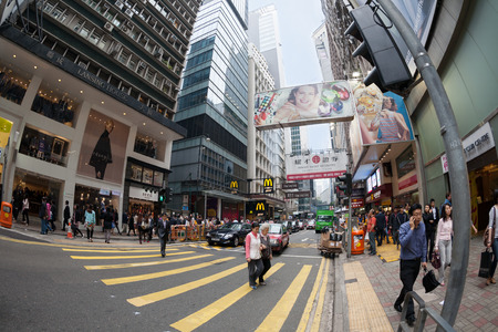 HONG KONG - NOVEMBER 14, 2012: People on the Queen's Road is a collection of roads along the northern coast of Hong Kong Island. It was the first road in Hong Kong, built by the British in 1841-1843. Stock Photo - 27957259