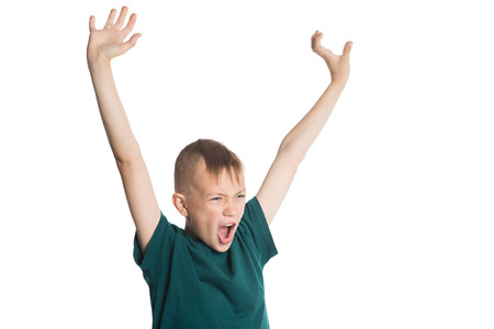 Screaming boy with hands raised isolated on white  photo