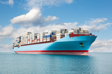 Large container carrier is at sea. Stock Photo