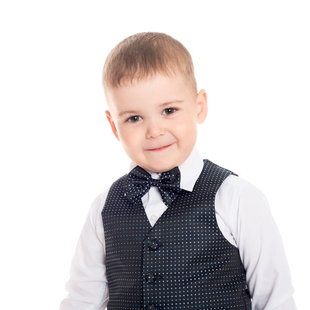 Little boy in a business suit with a bow tie. photo
