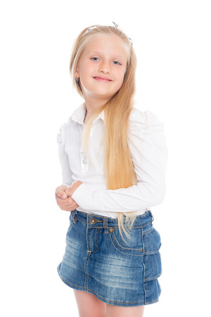 Pretty blond little girl isolated on white background. photo