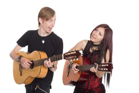 Musicians playing guitar. Interracial young couple, Asian woman and Caucasian man. photo