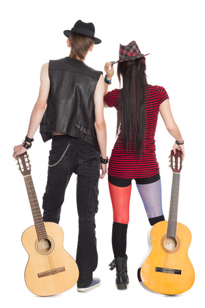 Young girl and the guy with the guitars, rear view.  photo