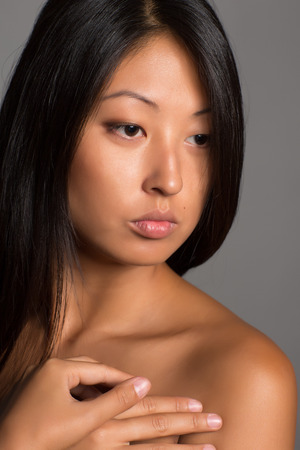 Young asian woman with naked shoulders. photo