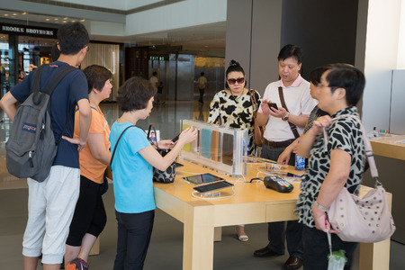 HONG KONG, CHINA - JUNE 18, 2014: Shoppers in Apple store in Hong Kong. Store is in a shopping center IFC Mall, it is very popular with locals and tourists visiting Hong Kong.