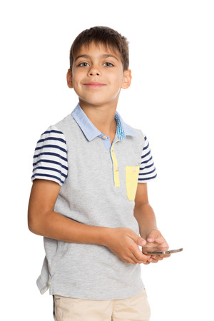 Smiling boy with a smartphone. Six years. photo