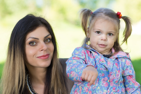 Mother and little daughter in park. photo