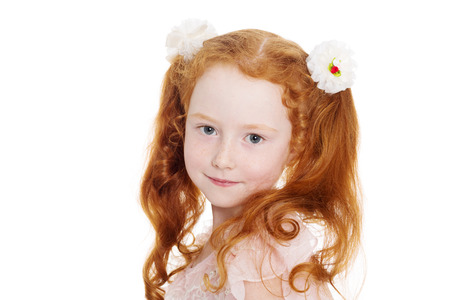 Little red haired girl with a bows. Girl is six years old. photo