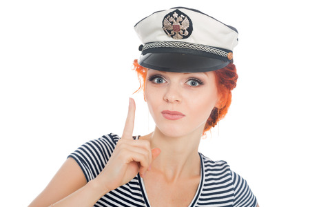 sailor girl: Sailor girl with a raised finger up. On his cap emblem of Russia. Stock Photo
