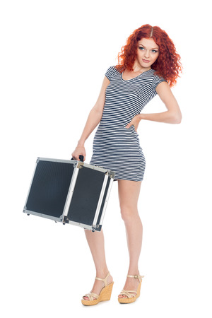 Beautiful slim girl with a black suitcase. Isolated on white. photo