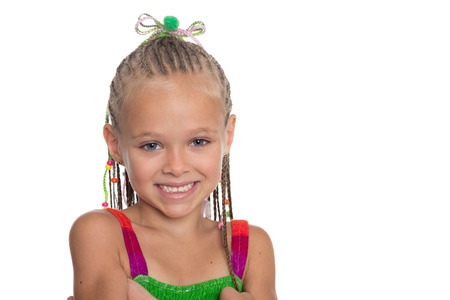 Close-up portrait of girl with dreadlocks. Girl is six years old.