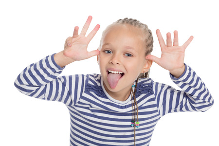 Little girl in the form of a sailor boy jokingly stuck out her tongue photo