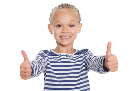 6 years girl: Happy smiling little girl with thumbs up gesture, isolated on white background