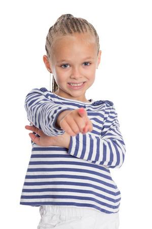 Joyful girl points a index finger forward photo