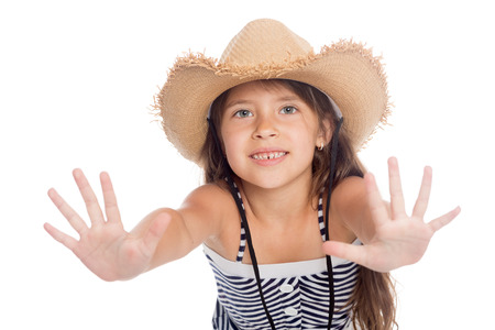 put forward: Cute little girl in a hat put forward hand.