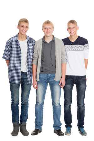 Three friends - two twin brothers and their best friend the same age. Isolated on wtite background photo