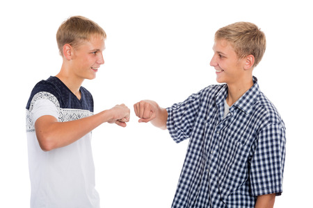 Two twin brothers greet each other with fists hands photo
