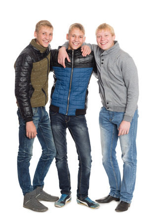 Group portrait of friends in full length. Two of the boys twin brothers photo