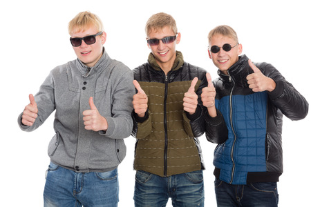 Friends with raised thumbs. Two of the boys twin brothers. photo