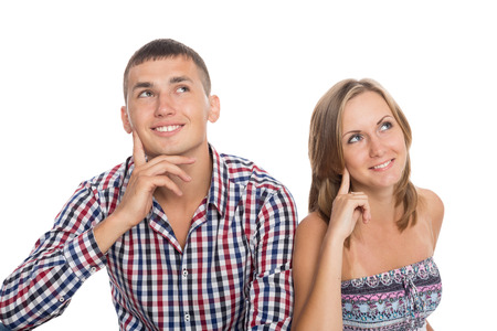 Lovers smiling young girl and the guy thoughtfully looking up photo