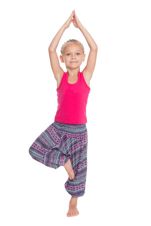 Sweet girl in great shape practicing yoga. Girl is six years old