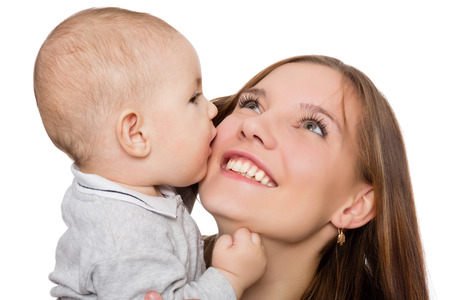 Happy young mother with her little baby boy cheerful photo