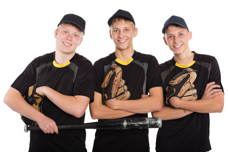 Young cheerful baseball players isolated on white background. Two of the boys twin brothers. photo