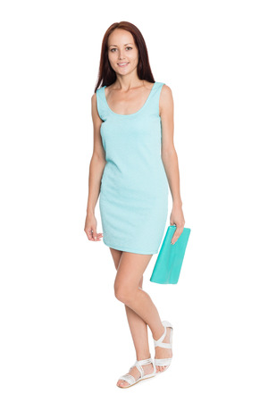 Happy young woman in a turquoise summer dress. Girl of twenty-seven years. photo