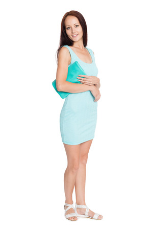 Beautiful young woman in turquoise dress in full growth. Girl of twenty-seven years. photo