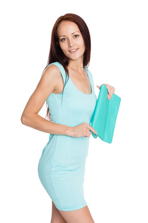 Beautiful young woman with a handbag isolated on white. Girl of twenty-seven years. photo