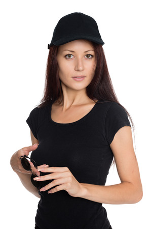 Beautiful young woman in a black baseball cap. Girl of twenty-seven years. photo