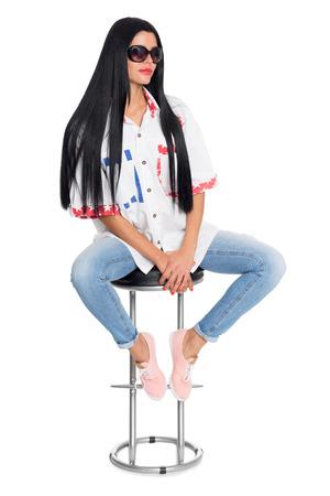 Young elegant woman sitting on a chair. Girl, twenty-six years. photo