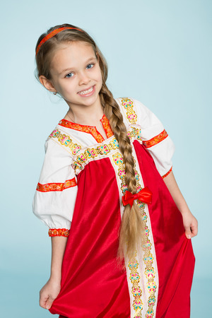 seven years: Girl in traditional Russian folk costume. Girl seven years.