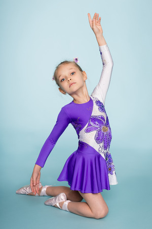 seven years: Cute girl performs a dance. Girl seven years.