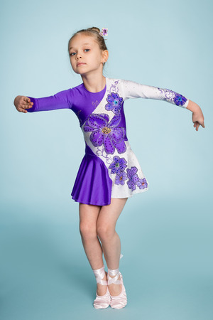seven years: Little cute girl performs a dance. Girl seven years.