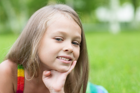 seven persons: Little girl with a serious look at the park. Girl seven years. Stock Photo