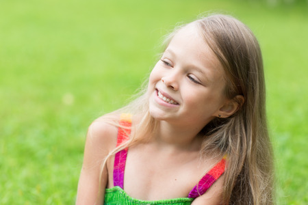 seven persons: Charming blond girl looking to the side. Girl seven years. Stock Photo
