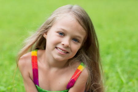 one little girl: Wonderful girl seven years for a walk in the park. Stock Photo