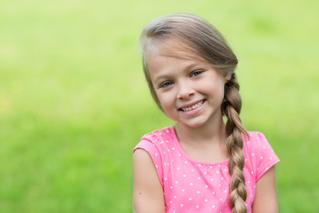 cute little girls: Smiling blond girl with braid. Girl seven years.