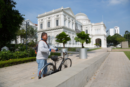 decorated bike: SINGAPORE - JANUARY 26, 2015: National Museum of Singapore is located in a historic building. Founded in 1848, the museum has grown from a personal collection and the library of Sir Stamford Raffles.