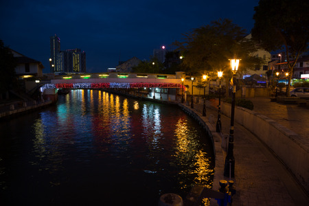 Malacca river embankment at night. Malacca, Malaysia. photo