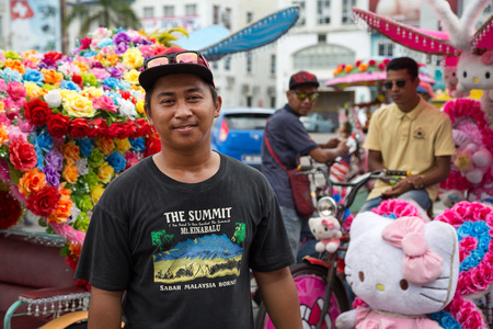flamboyant: MALACCA, MALAYSIA - CIRCA JANUARY, 2015: Portrait of an unusually flamboyant Malay rickshaw man in a hat, met on the street in Malacca. Editorial