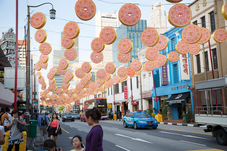 festively: SINGAPORE - FEBRUARY 17, 2015: Festively decorated streets on the eve of Chinese New Year in Chinatown in Singapore. Chinese composition of 77% of the population of Singapore. Editorial