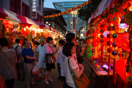 SINGAPORE - FEBRUARY 17, 2015: Entertainment representation using quadcopter in Chinatown on the eve of Chinese New Year. Chinese composition of 77% of the population of Singapore.