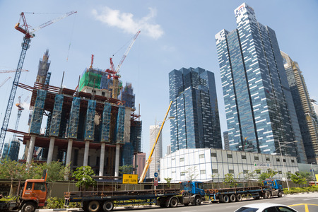 SINGAPORE - FEBRUARY 18, 2015: Grandiose construction of the Marina One Mixed Development Project in Singapore with the company Hyundai. This project builds on a Central Boulevard. Stock Photo - 38658841