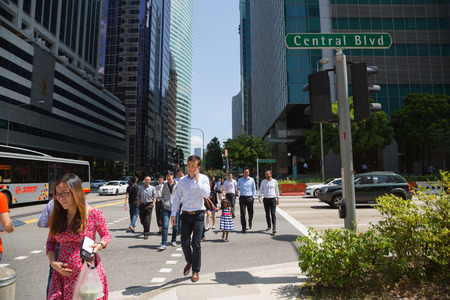 SINGAPORE - FEBRUARY 18, 2015: Singapore's Central Business District (CBD), the intersection Raffles Quay and Central Boulevard. The business district is a symbol of dynamic Singapore.