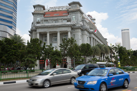 commissioned: SINGAPORE - FEBRUARY 18, 2015: Famous The Fullerton Hotel in Singapore is a five-star luxury hotel located on the Fullerton Road. Commissioned in 1919.